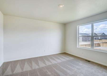 Roosevelt new home plan with recessed light, light brown carpet, and large window