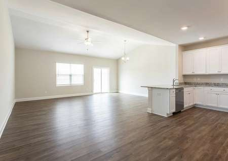Allatoona kitchen-living area with wood-like flooring, white cabinets, and off white painted walls