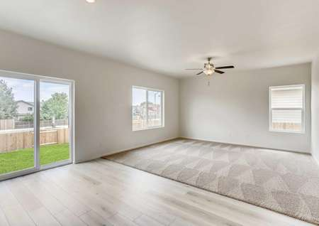 Yale family room with ceiling fan and dining area with hardwood floors and glass patio door