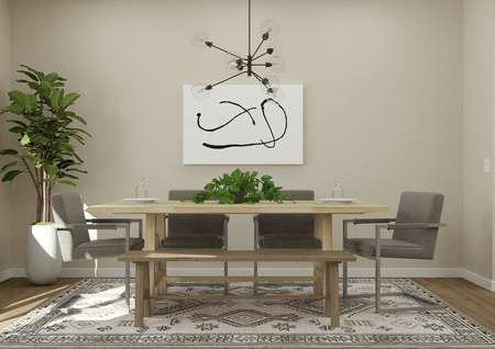 Rendering of the Allatoona plan's dining   area adjacent to the kitchen with wood-look flooring covered by a gray and   white rug, tan walls, large wood rectangle table and potted plant.