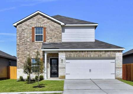 Carson two-story home street view with white two-car garage, brick siding, and landscaped yard