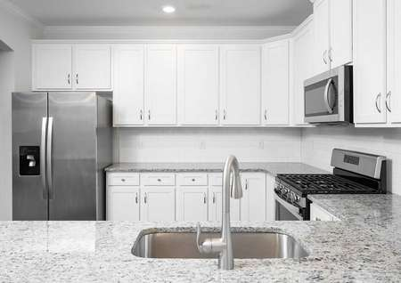 The Fripp kitchen with gorgeous white cabinets and stainless steel appliances.