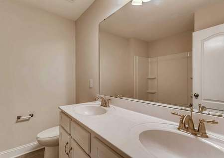 Hawthorn bath with two sinks, large mirror, and white fixtures