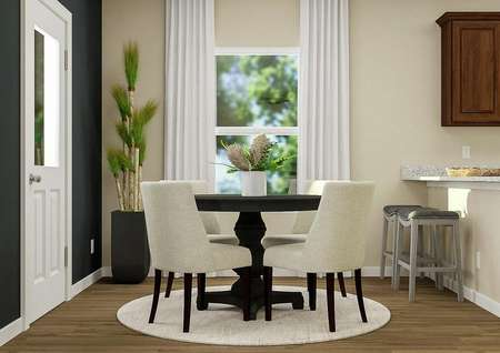 Rendering of dining   area with wood-look flooring, round table with rug, window with white   curtains and door to back yard