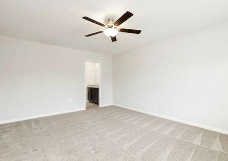 The Mid Atlantic Jordan master bedroom shown with decorative ceiling fan and carpet flooring.