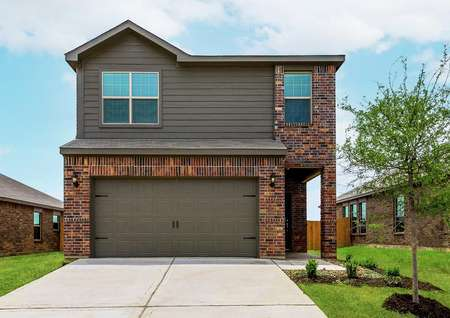 This two-story home has a beautiful brick and siding exterior with a two-car garage.
