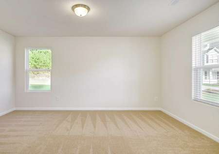 Madison bedroom with multiple windows, ceiling lighting, and brown carpet floor