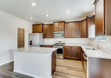 Roosevelt kitchen with modern cabinets, undermount sink, and light color granite countertops