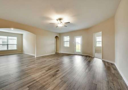 The spacious living room and formal dining areaof the Houghton floor plan with vinyl wood flooring throughout.