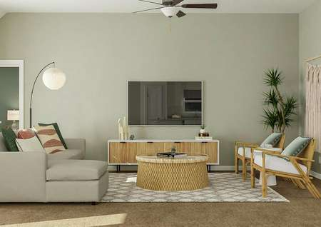 Rendering of living room with round   coffee table, large storage space, and tv above storage.