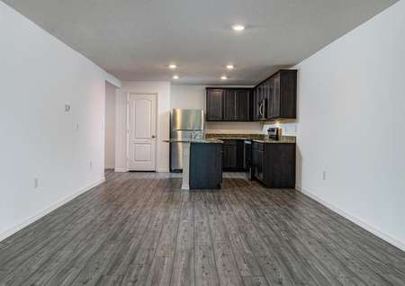 Family room overlooking the home's kitchen with all new appliances.