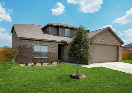 Cypress single-family house front yard, with green grass, two-car garage, and brick siding