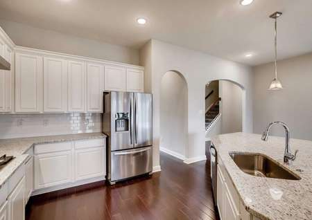 Timberline kitchen completed with can lights, brown tile floor, and stainless steel appliances