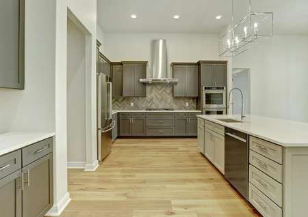 The chef-ready kitchen has stainless steel appliances and stunning wood cabinetry.
