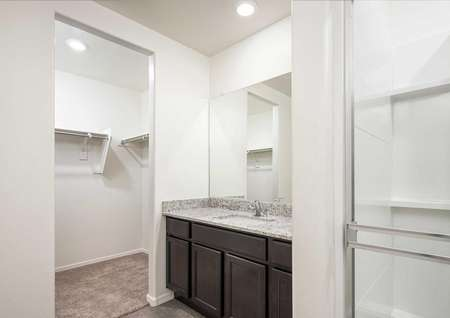 The Luna floorplan shows the master bath room with granite countertops and a view of the walk in closet.