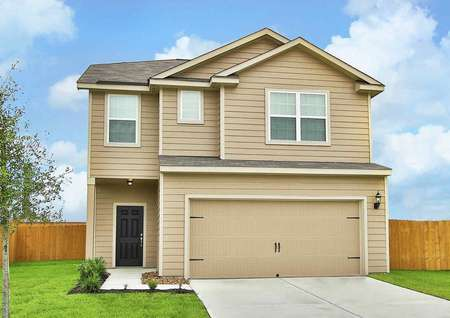 The front of the Juniper model home. Tan exterior two-story home with a 2-car garage and grass front-yard