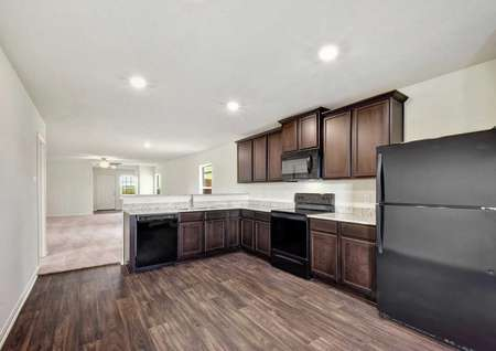 Hawthorn kitchen with wood cabinets, recessed lights, and wood flooring