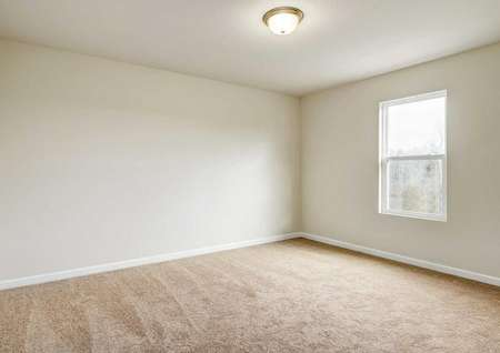 Hartford bedroom with white on grey walls, ceiling lighting, and light brown carpet floors