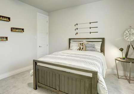 Staged bedroom with golf club decor.