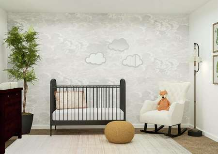 Rendering of a bedroom decorated as a   nursery and furnished with a crib, dresser, rocking chair and mirrors in the   shape of clouds.