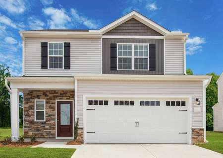 Avery elevation front with white two-car garage doors, window shutters, and green grass