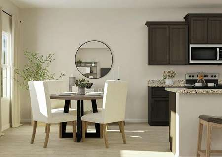 Rendering of dining area with light   wood-look flooring, round table with white chairs and kitchen with brown   cabinets to the right