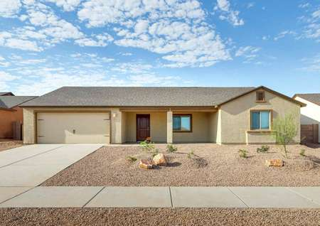 The Luna front exterior view of a single story home with desert landscaping.
