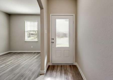 Maple entryway with white front door with window, dark brown wood flooring, and gray on white trimmed walls