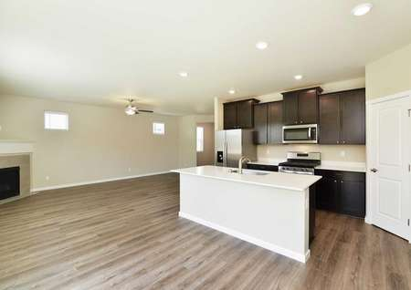 Larch dining area and kitchen with wood floors, recessed lights, and plenty of counter space
