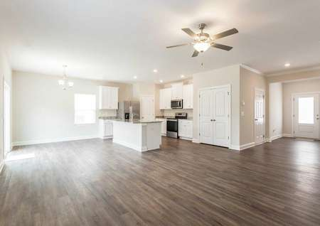 Avery great room with wood floors, chandelier, and white-finish kitchen