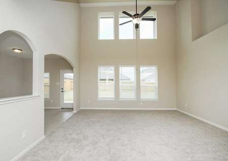 Carpeted living room with ceiling fan and light in the Redwood floor plan