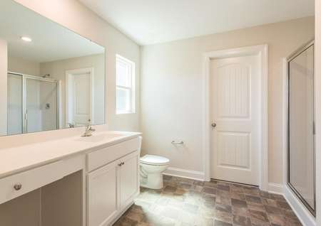Jackson master bath with walk-in shower, tile flooring, and large vanity