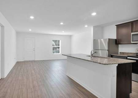 Kitchen island overlooking the front entrance and dining room.