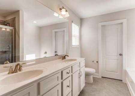Hawthorn bath with two sinks, extended vanity mirror, and wall-mounted lights