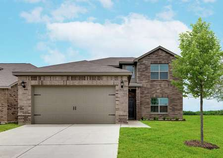 The Oakmont has a beautiful brick exterior and lush front yard landscaping.