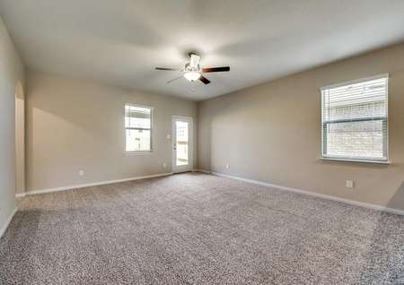 Maple family room with ceiling fan, light gray colored walls, and soft carpeted floors