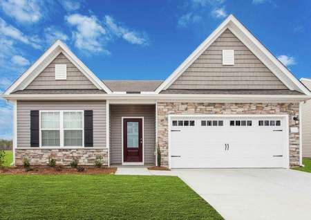 Allatoona exterior elevation front with rock façade, green grass, and carriage-style garage