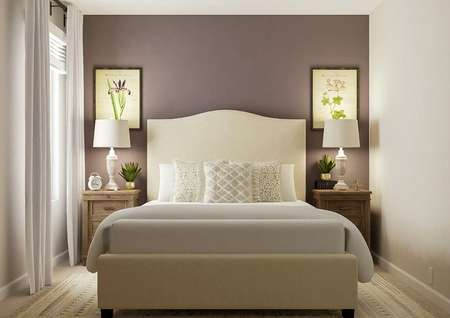 Rendering of a spacious bedroom furnished   with a large bed, two nightstands and a mirror. The space has a window and   carpeted flooring.