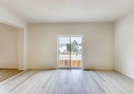 Harvard great room with wood tile floors, and sliding glass patio door, and white finished walls