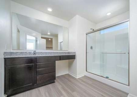Redondo master bathroom with granite countertops, makeup counter, and walk in shower